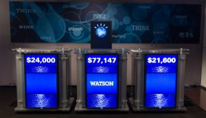 Jeopardy! podiums showing final scores, with IBM Watson in the center.