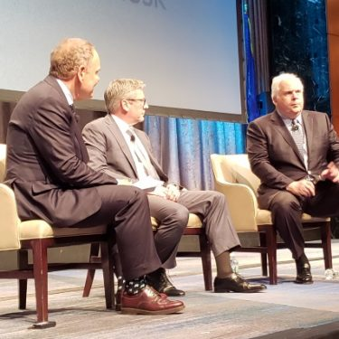 Panel at Consensus (R to L): Frederick W. Smith, Founder and CEO of FedEx; Robert Carter, EVP of FedEx Information Services and CIO; and author Don Tapscott (moderator).