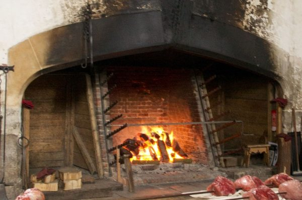 The word 'backlog' originally meant a large log at the back of the hearth.