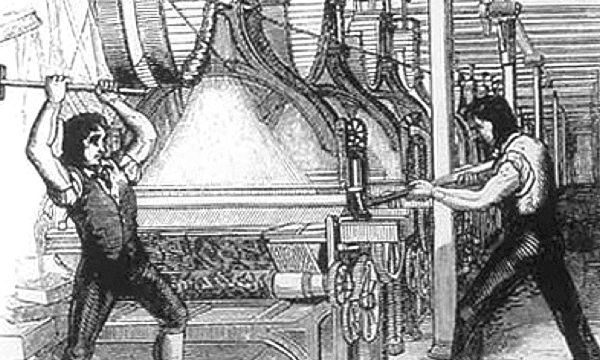 Luddites destroying an automated loom.